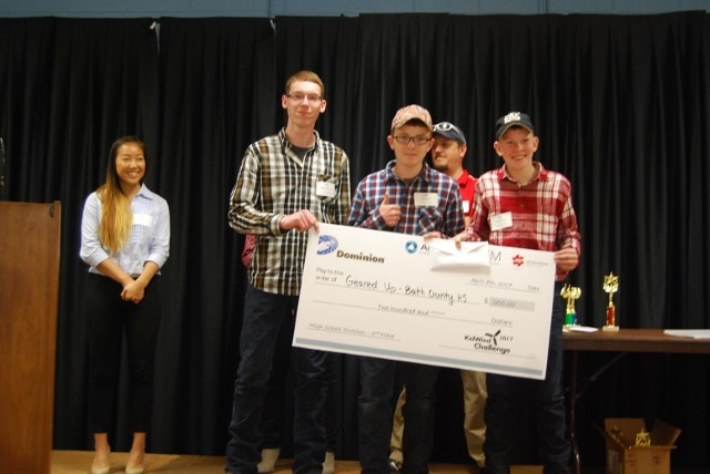 """Students accepting the Third Place Award for the""""Geared Up"""" turbine for the 2017 KidWind competition at Dabney S Lancaster Community College on April 8, 2017."""