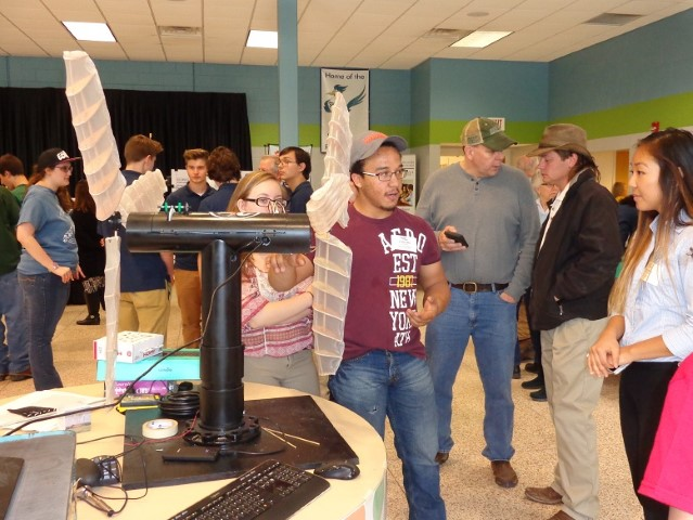 """Students explaining """"The Sleeper"""" wind turbine to judges for the 2017 KidWind competition at Dabney S Lancaster Community College on April 8, 2017."""